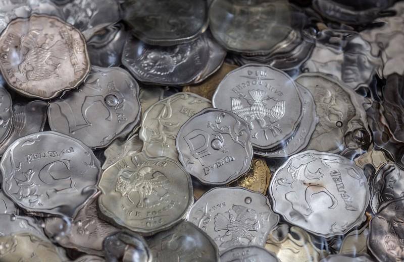Аналитики оценили, как рекордные дивиденды компаний повлияют на курс рубля