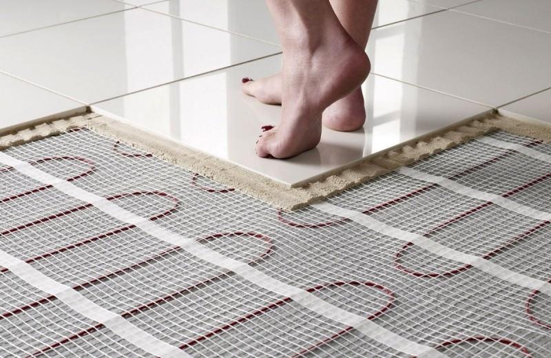 Какой электрический теплый пол положить под плитку и ламинат?