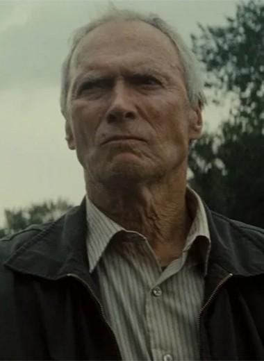 Портрет молодого человека с пистолетом в руке
